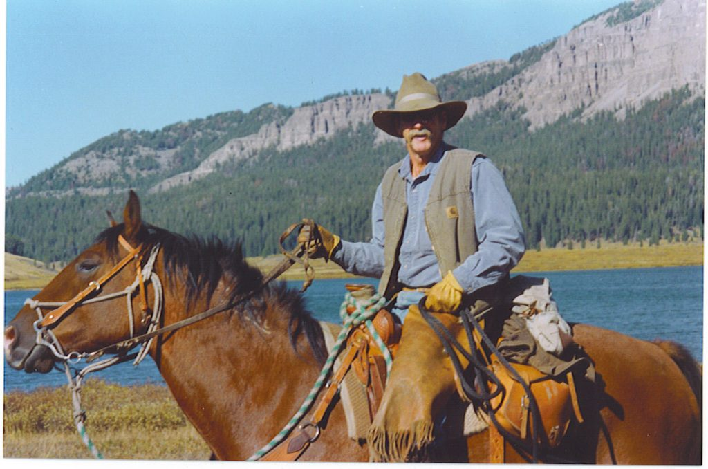 Man riding a horse in the mountains