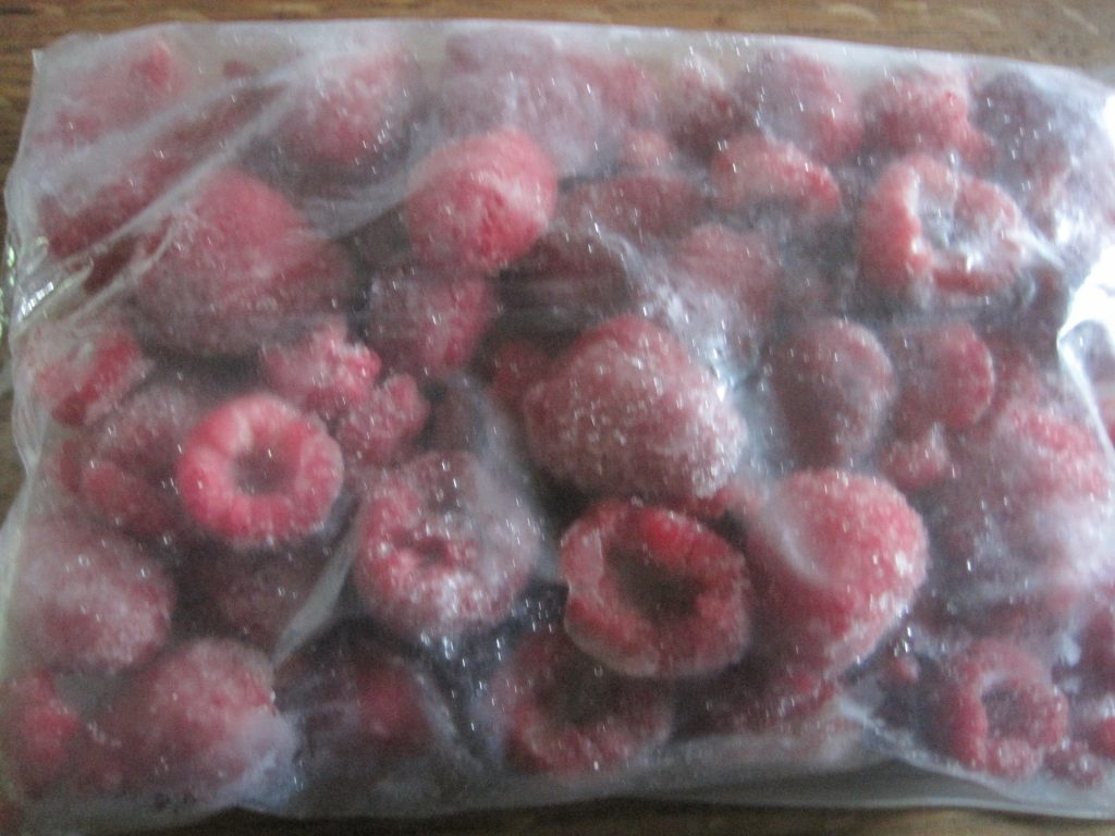 Place Individually Frozen Raspberries in Plastic Freezer Bags