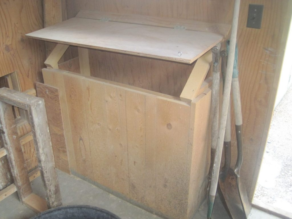 Wooden Feed Bin inside the Chicken Coop is both convenient and rodent proof.