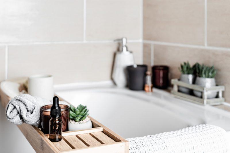 bath tub with tile walls