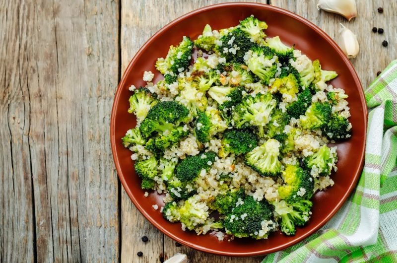 broccoli and quinoa salad in a red bowl is one of the healthy salad reicpes