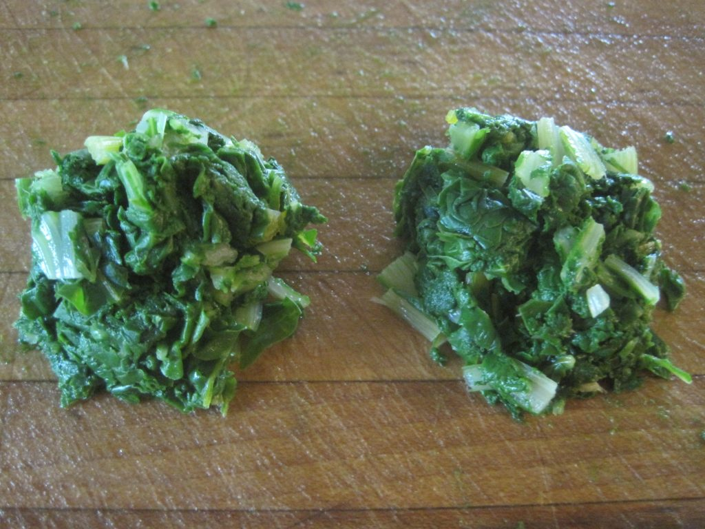 Form the cooled kale, spinach or chard into small balls and then place on a cookie sheet so they can be frozen individually.