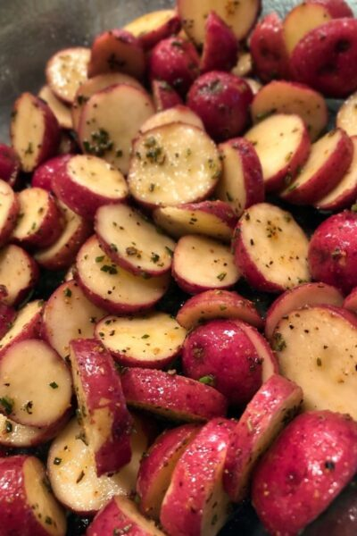 small sliced red potatoes ready to be roasted in the oven