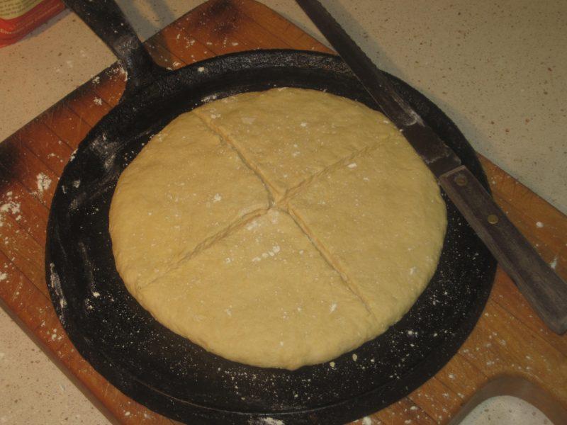 Flat bread dough on a black cast iron skillet
