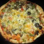 This easy homemade pizza uses tortillas for the crust.