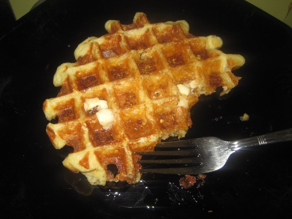 Homemade waffle made with Einkorn flour on a plate with a fork