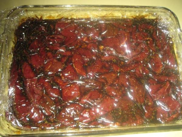 Jerky meat marinading in brine.