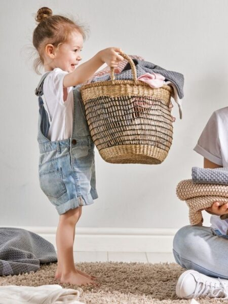 little girl helping do the laundry as a gift of time