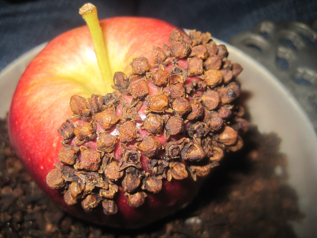 Pushing Cloves in Apple