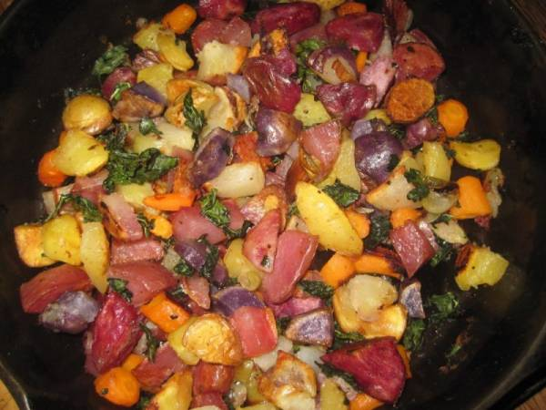 Roasted Potatoes, Carrots, Onions and Kale in cast iron skillet