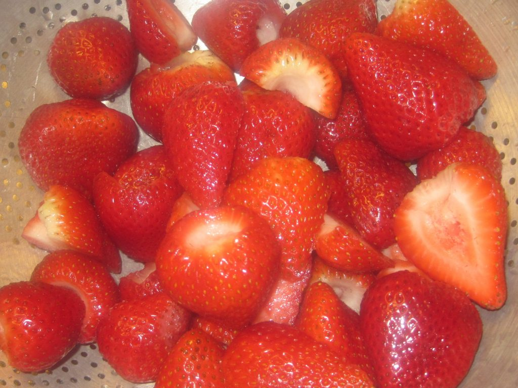 It is important to rinse strawberries prior to freezing.