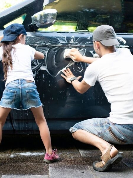 two kids washing a car on a gift of time coupon