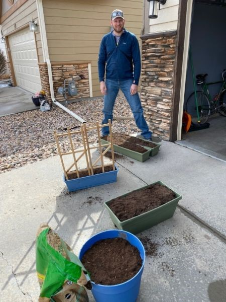 Young man getting ready to plant a container garden