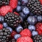This is a photo of blueberries, black berries, raspberries, and black berries; learn how to freeze all these berries!