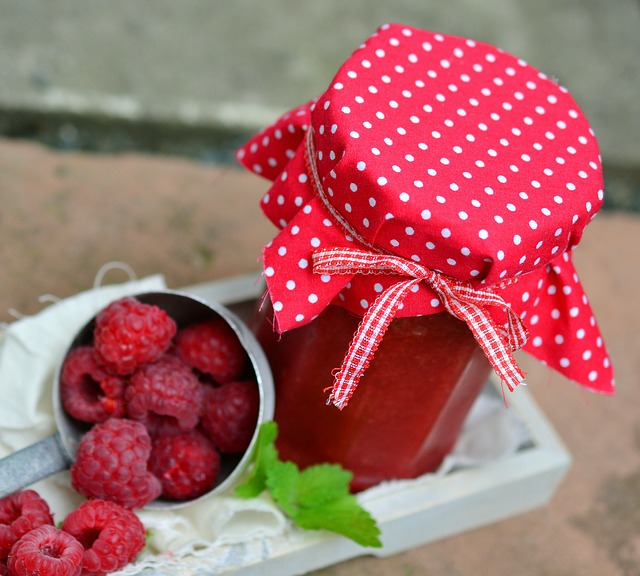 low sugar mixed berry jam in a jar with a red polka dot lid cover and ribbon