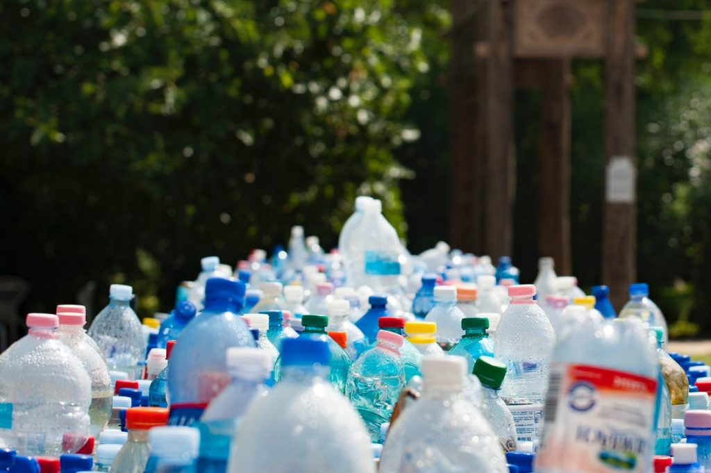 a lot of plastic bottles and jugs that are ready to be recycled at a recycling center